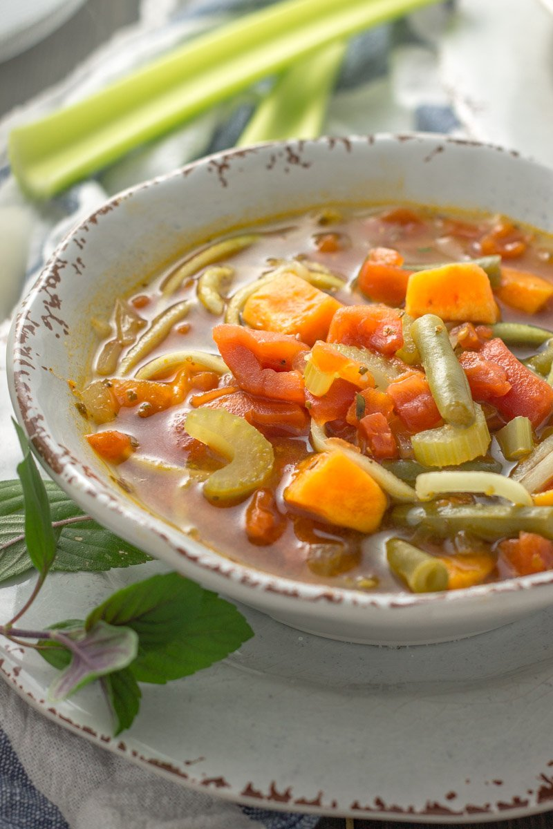 This Whole30 minestrone soup is the perfect comfort food, packed with veggies and zucchini noodles!