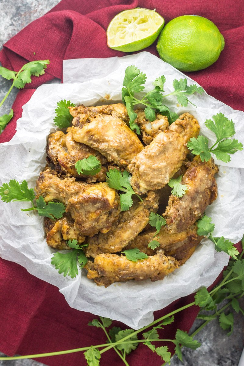 These slow cooker Thai chicken wings are paleo and Whole30. Made with a rich almond butter sauce, they're the easiest football appetizer this fall!