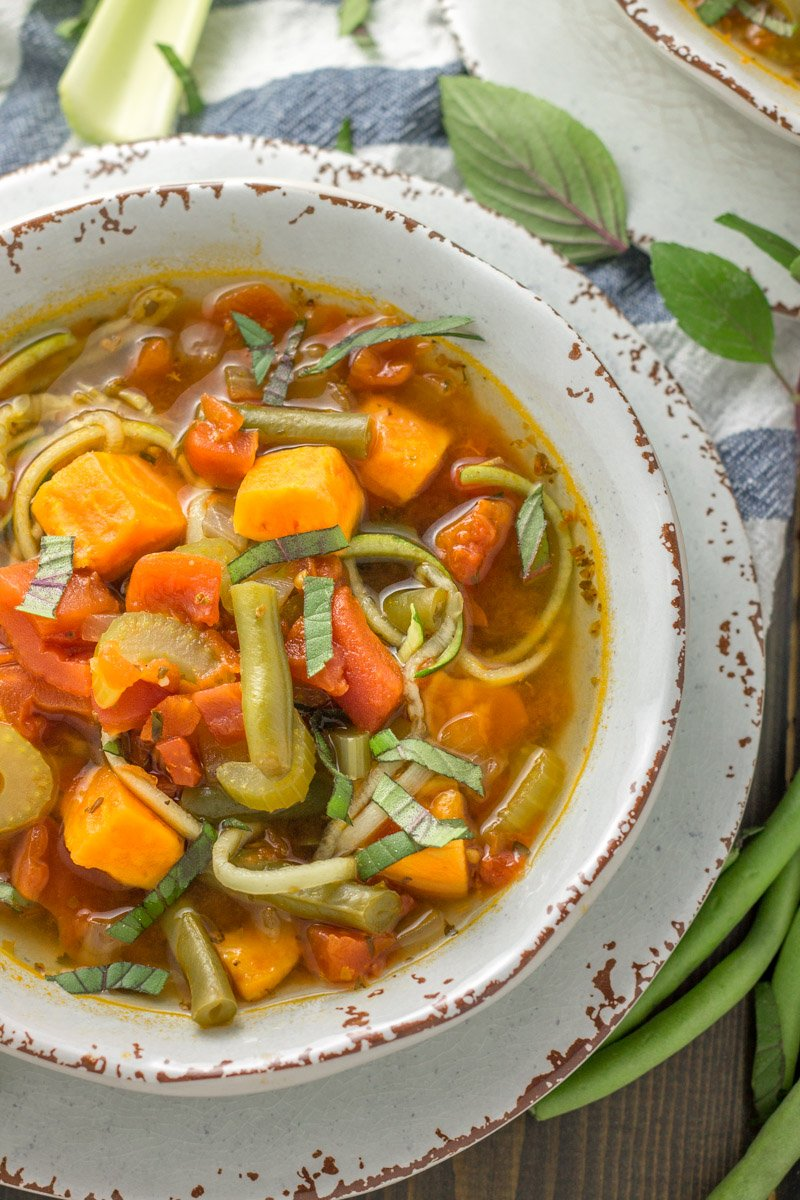 This vegetarian Whole30 soup is inspired by classic minestrone, using sweet potatoes and zucchini noodles!