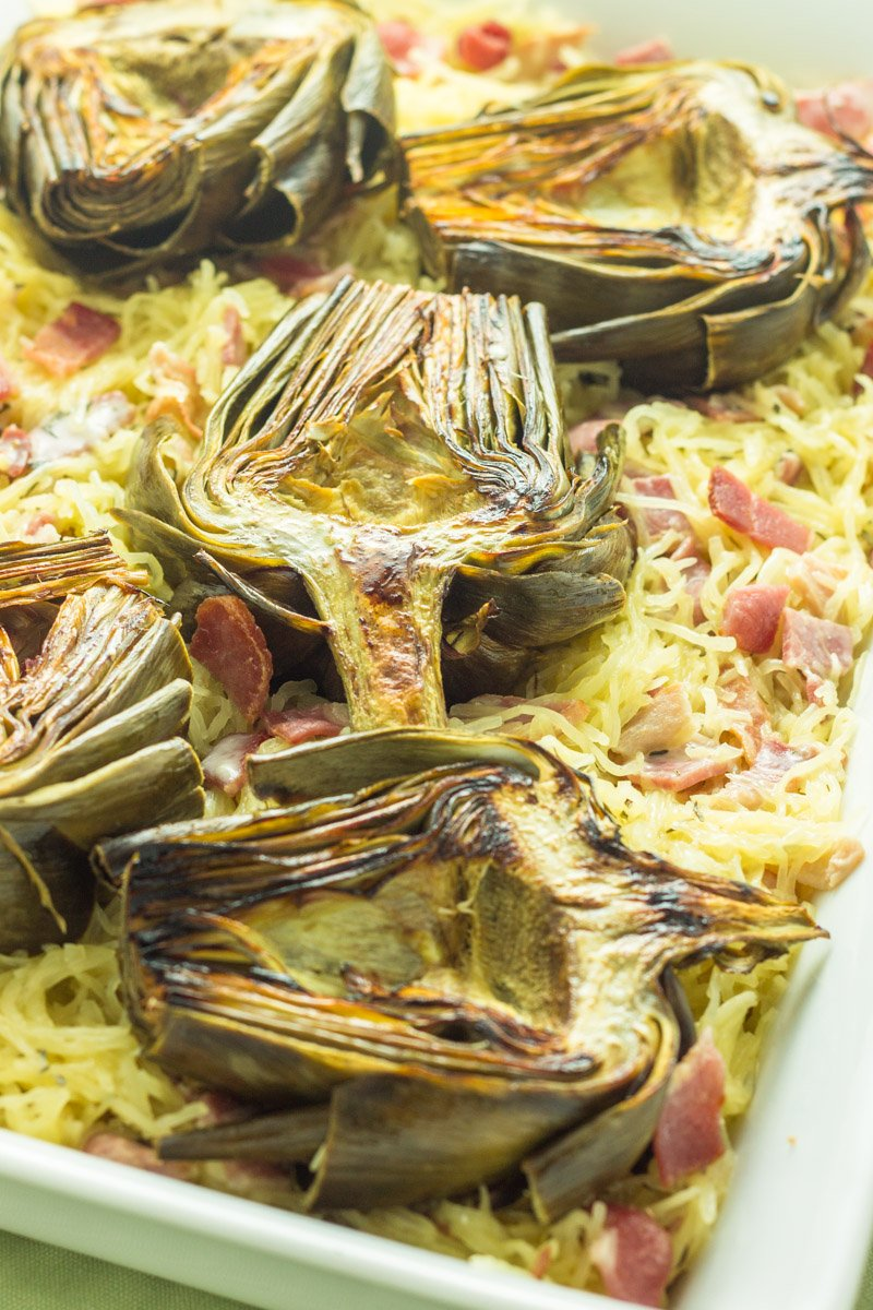 Roasted artichokes pair beautifully with this Whole30 bacon and artichoke spaghetti squash. Creamy and delicious!