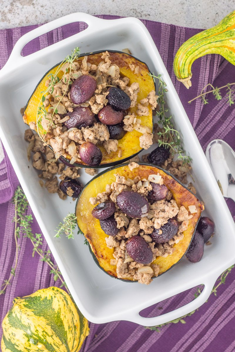Paleo & Whole30 stuffed acorn squash with roasted grapes and ground turkey