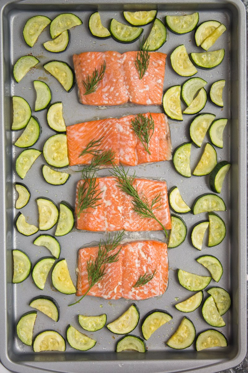 Quick and easy sheet pan salmon - it's healthy, whole30 compliant, and includes THE most amazing sweet and savory dijon cream sauce