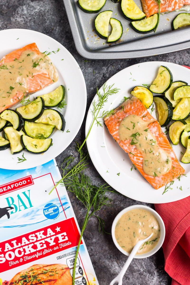 This 20 minute sheet pan salmon with creamy dijon sauce is whole30 compliant and so simple to make. A winner with both kids and adults