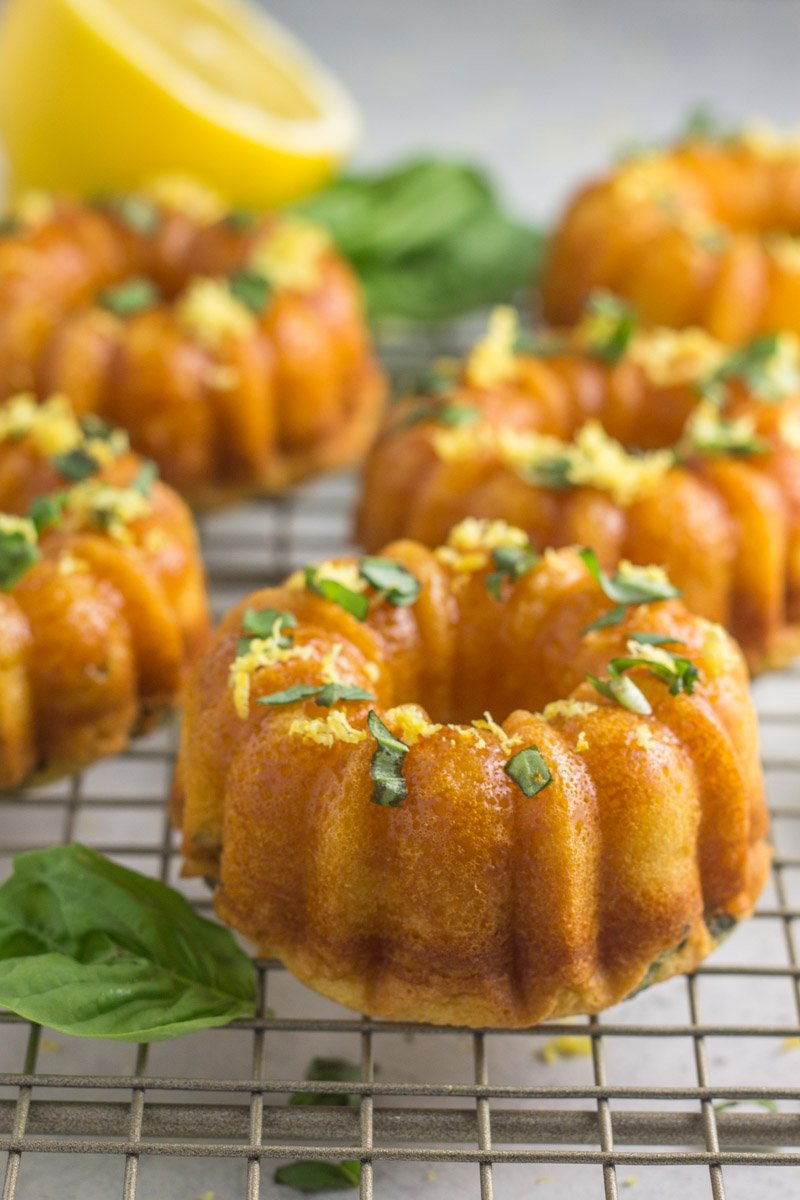 These paleo lemon basil mini bundt cakes are grain free, naturally sweetened, and the perfect dessert for entertaining