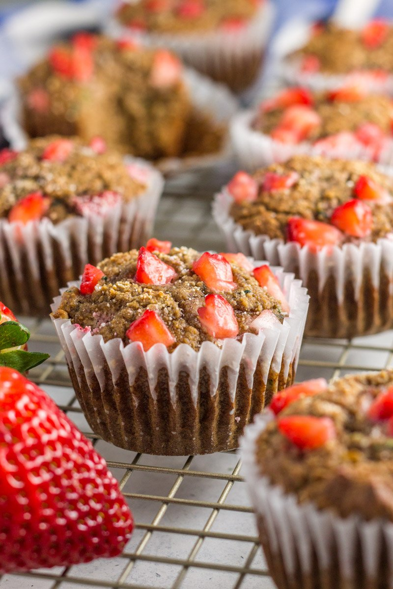 A healthy paleo muffin packed with healthy fat, fruit, and vegetables. Almond butter strawberry zucchini muffins