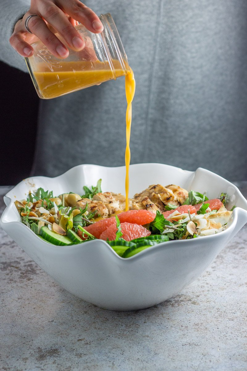 A tropical salad with chicken, grapefruit, and toasted coconut. With grapefruit vinaigrette
