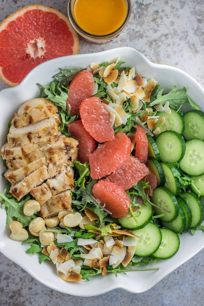 This paleo, Whole30 compliant tropical salad is packed with chicken, macadamia nuts, grapefruit, and toasted coconut. With a clean and delicious homemade dressing