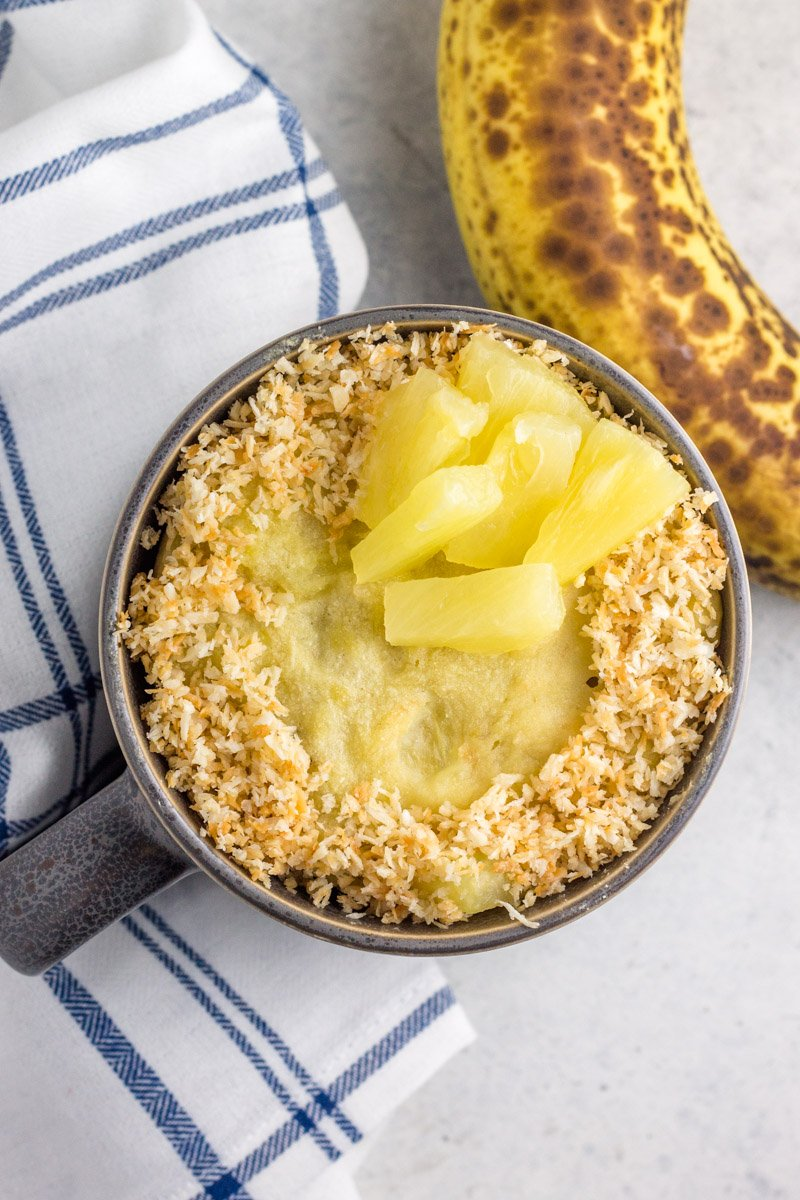 Paleo banana mug cake infused with pineapple and toasted coconut!