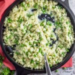 Cauliflower rice risotto with goat cheese and spring peas. A low carb, one pot meal made in under 20 minutes!