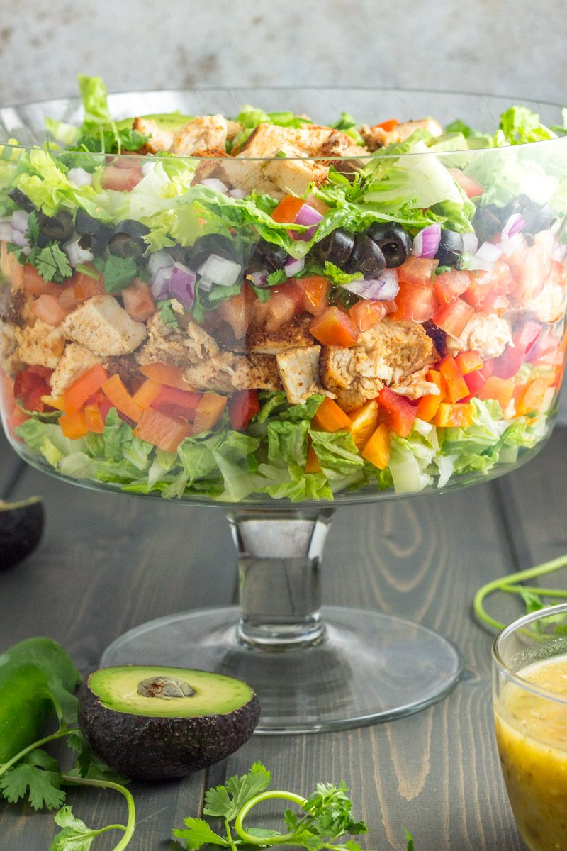 This layered taco salad is the healthiest taco-inspired dish ever! No processed junk, gluten free, and dairy free