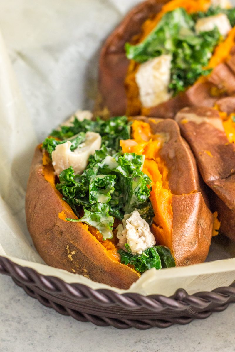 A healthy dinner with a classic take. This whole30 and paleo chicken kale caesar salad is stuffed in a sweet potato for extra flavor!