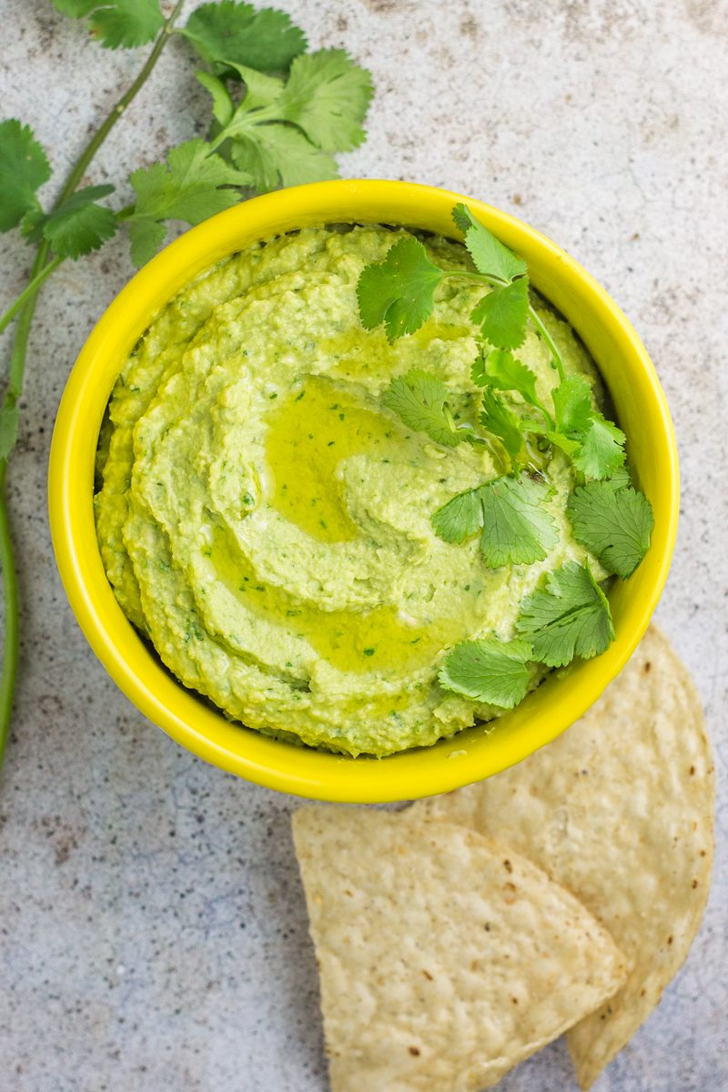 This avocado cilantro hummus is a healthy dip with a touch of lime. Vegetarian, vegan, paleo