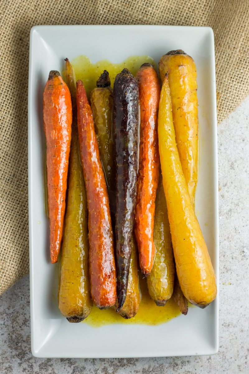 These honey citrus curried carrots are sweet like candy, with an array of comforting spices and perfect for a dinner side dish. Paleo + Vegan